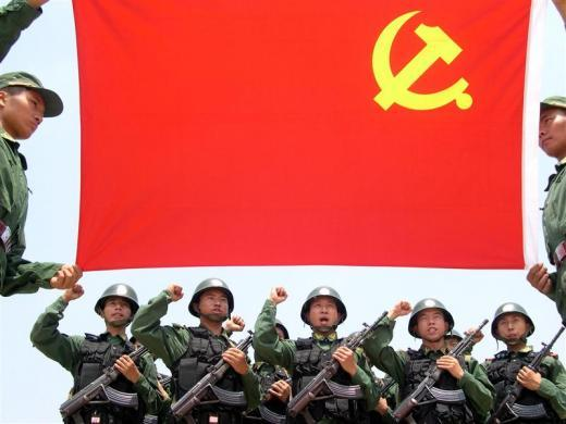 Chinese soldiers take an oath in front of a Chinese Communist Party (CCP) flag in Wuhan, central China's Hubei province, June 29, 2005.