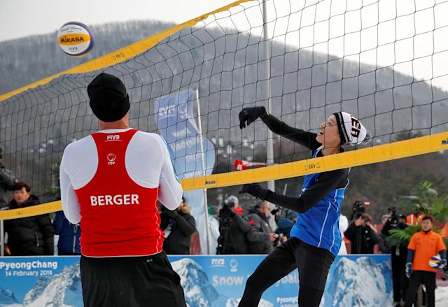 Pyeongchang 2018 Winter Olympics - Pyeongchang - South Korea – February 14, 2018. Nikolas Berger of Austria and Kim Yeon-Koung of South Korea in action during an event promoting the Snow Volleyball hosted by the International Volleyball Federation (FIVB) and European Volleyball Confederation (CEV). REUTERS/Kim Hong-Ji