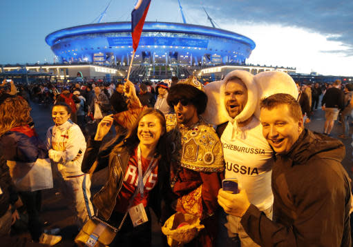 Russian fans celebrate Russia's 3-1 victory over Egypt in the group A match at the 2018 soccer World Cup near the St. Petersburg stadium in St. Petersburg, Russia, Tuesday, June 19, 2018. (AP Photo/Dmitri Lovetsky)