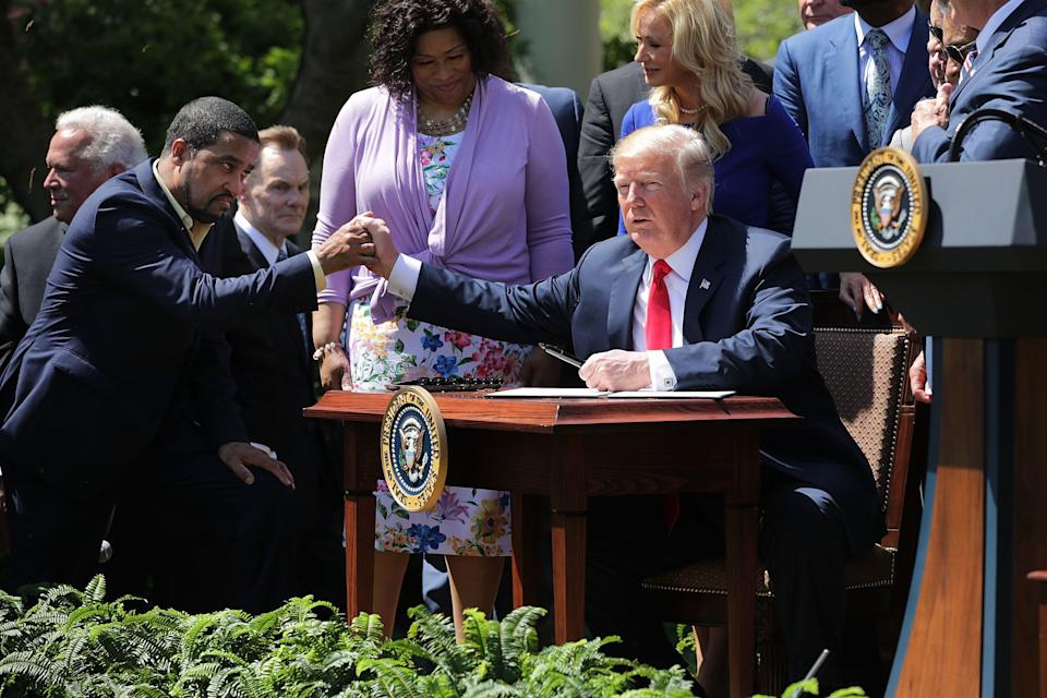 Pastor Darrell Scott and President Donald Trump shake hands at the the National Day of Prayer ceremony in the White House Rose Garden. (Photo: Chip Somodevilla via Getty Images)