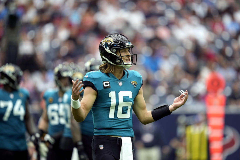 Jacksonville Jaguars quarterback Trevor Lawrence (16) reacts after a penalty called against the offense during the first half of an NFL football game against the Houston Texans Sunday, Sept. 12, 2021, in Houston. (AP Photo/Sam Craft)