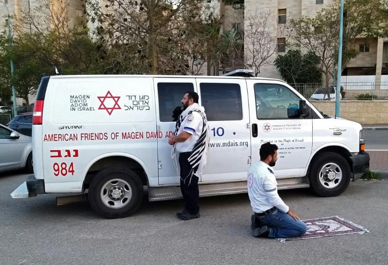 A photo from Israel's equivalent of the Red Cross, the Magen David Adom, shared widely on social media this week showed two medics -- one Jewish and one Muslim -- pausing to pray in front of their ambulance