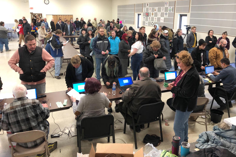 Voters wait in line for the North Dakota Democratic presidential caucus in a union hall in Fargo, N.D., on Tuesday, March 10, 2020. The strong turnout forced party officials to bring in extra equipment and volunteers. (AP Photo/Dave Kolpack)