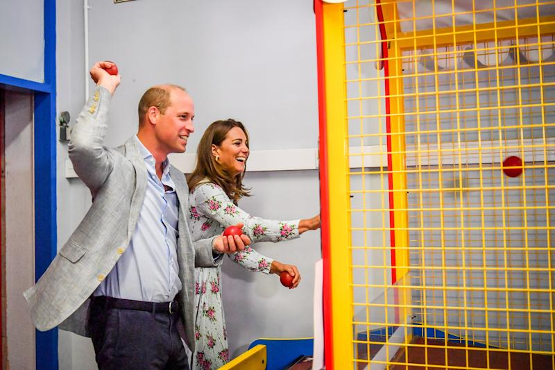 The Duke and Duchess of Cambridge throw balls to knock down figures on an arcade game at Island Leisure Amusement Arcade, where Gavin and Stacey is filmed, during their visit to Barry Island, South Wales, to speak to local business owners about the impact of COVID-19 on the tourism sector.