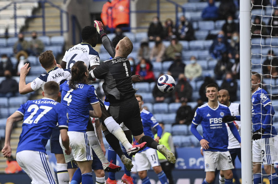 Leicester's goalkeeper Kasper Schmeichel, center, scores an own goal during the English Premier League soccer match between Leicester City and Tottenham Hotspur at the King Power Stadium, in Leicester, England, Sunday, May 23, 2021. (Shaun Botterill/Pool via AP)