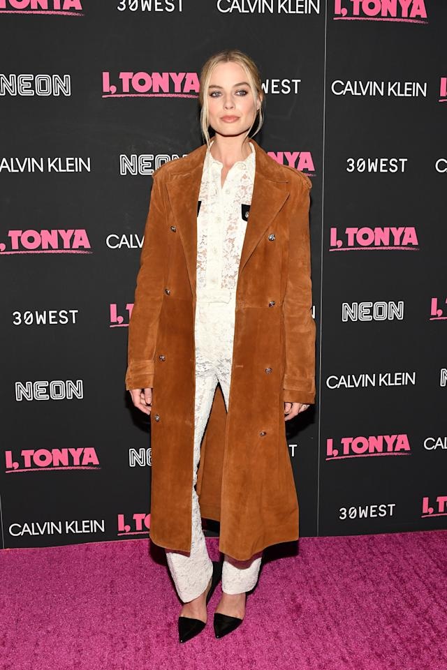 <p>The actress wore a white lace jumpsuit with a cognac suede coat for the premiere of her new movie. (Photo: Getty Images) </p>