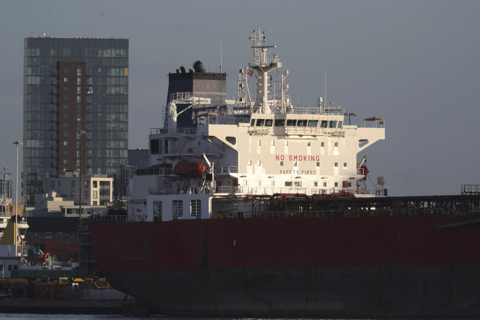 The Nave Andromeda oil tanker is docked next to the Queen Elizabeth II Cruise Terminal in Southampton, England, Monday, Oct. 26, 2020. The U.K. military seized control of the oil tanker that dropped anchor in the English Channel after reporting it had seven stowaways on board who had become violent. (Andrew Matthews/PA Wire via AP)