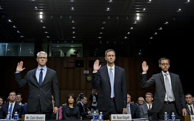 Executives from Facebook, Twitter and Google swear in at a previous Senate hearing in 2017 - Bloomberg