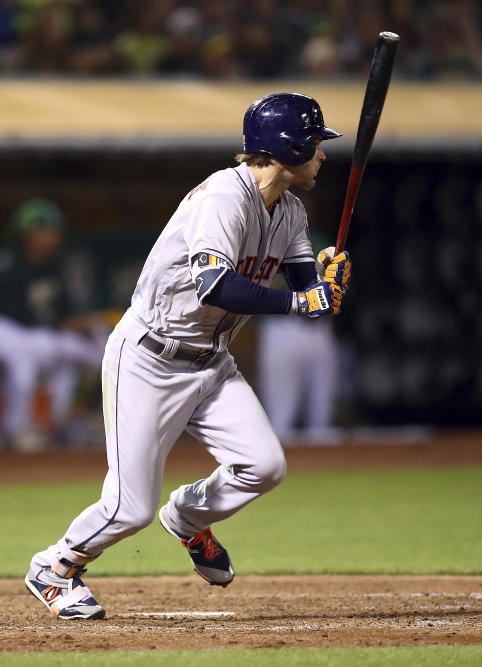 Houston Astros' Josh Reddick watches his RBI single against the Oakland Athletics during the sixth inning of a baseball game Friday, Aug. 17, 2018, in Oakland, Calif. (AP Photo/Ben Margot)