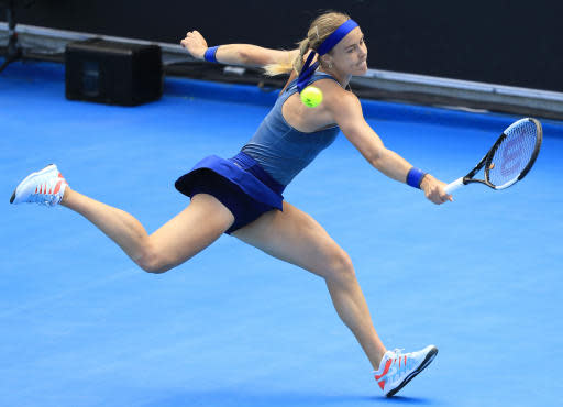Anna Karolina Schmiedlova of Slovakia hits a backhand to Sofia Kenin of the U.S. during the women's singles finals at the Hobart International tennis tournament in Hobart, Australia, Saturday, Jan. 12, 2019. (Rob Blakers/AAP Image via AP)