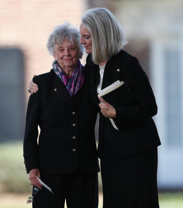 <p>Sisters of Billy Graham, Jean Ford and Virginia Graham embrace during a funeral service at the Billy Graham Library for the Rev. Billy Graham, who died last week at age 99, Friday, March 2, 2018, in Charlotte, N.C. (Photo: John Bazemore/AP) </p>
