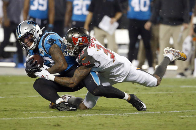 Carolina Panthers wide receiver D.J. Moore (12) is tackled by Tampa Bay Buccaneers cornerback Carlton Davis (33) during the first half of an NFL football game in Charlotte, N.C., Thursday, Sept. 12, 2019. (AP Photo/Brian Blanco)