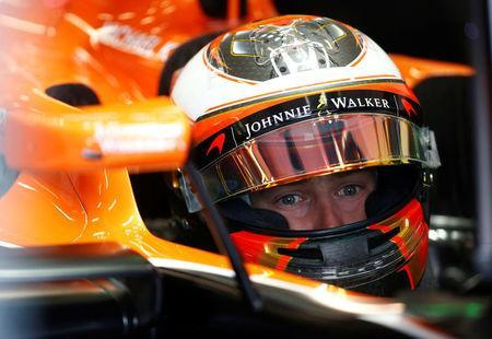 Formula One - F1 - Australian Grand Prix - Melbourne, Australia - 24/03/2017 McLaren driver Stoffel Vandoorne of Belgium sits in his car during the second practice session. REUTERS/Brandon Malone