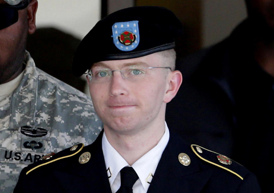 FILE - In this June 25, 2012 file photo, Army Pfc. Bradley Manning, right, is escorted out of a courthouse in Fort Meade, Md. The Army private charged in the largest leak of classified material in U.S. history says he sent the material to WikiLeaks to enlighten the public about American foreign and military policy on Thursday, Feb. 28, 2013. (AP Photo/Patrick Semansky, File)
