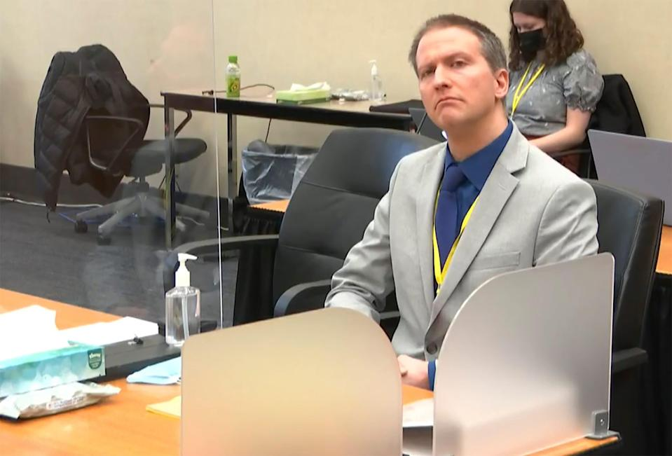 In this image from video, former Minneapolis police Officer Derek Chauvin listens as his defense attorney Eric Nelson gives closing arguments as Hennepin County Judge Peter Cahill preside Monday, April 19, 2021.