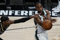 Milwaukee Bucks forward Khris Middleton, right, passes the ball as Atlanta Hawks forward Cam Reddish, left, defends during the second half in Game 6 of the Eastern Conference finals in the NBA basketball playoffs Saturday, July 3, 2021, in Atlanta. (AP Photo/John Bazemore)
