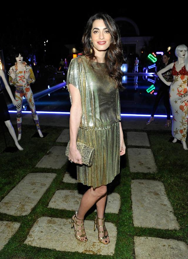 Amal Clooney glowed in gold at the Farfetch and William Vintage x Gianni Versace archive event in Los Angeles. (Photo: Getty Images)