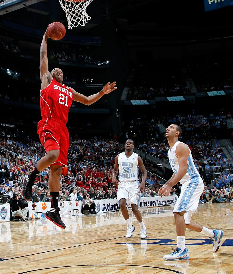 ATLANTA, GA - MARCH 10:  C.J. Williams #21 of the North Carolina State Wolfpack dunks against Kendall Marshall #5 of the North Carolina Tar Heels during the semifinals of the 2012 ACC Men's Basketball Conference Tournament at Philips Arena on March 10, 2012 in Atlanta, Georgia.  (Photo by Kevin C. Cox/Getty Images)