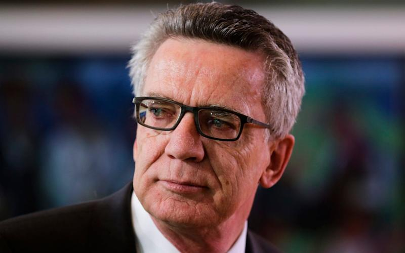 German Interior Minister Thomas de Maiziere arrives for the weekly cabinet meeting of the German government at the chancellery in Berlin - AP