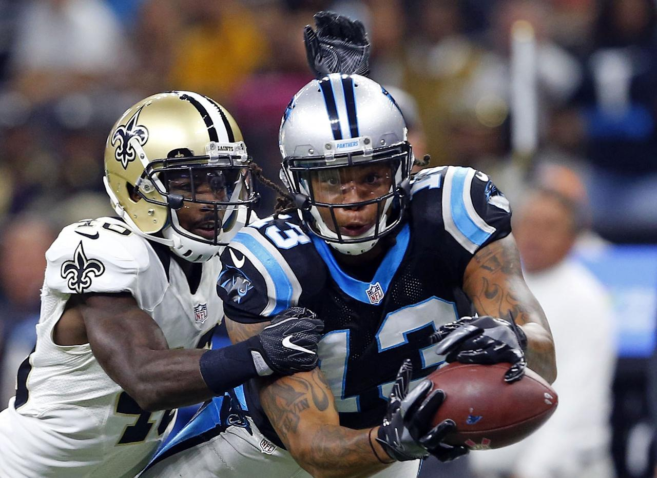<p>Carolina Panthers wide receiver Kelvin Benjamin (13) tries to pull in a pass as New Orleans Saints cornerback Ken Crawley (46) covers in the first half of an NFL football game in New Orleans, Sunday, Oct. 16, 2016. (AP Photo/Butch Dill) </p>