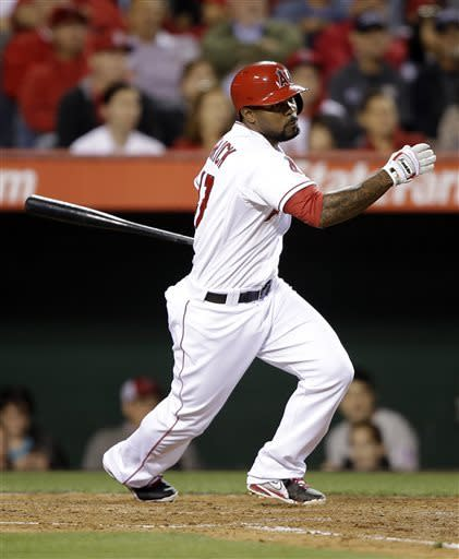 Los Angeles Angels' Howie Kendrick follows through on a two-RBI double during the fourth inning of a baseball game against the Texas Rangers in Anaheim, Calif., Monday, April 22, 2013. (AP Photo/Jae C. Hong)