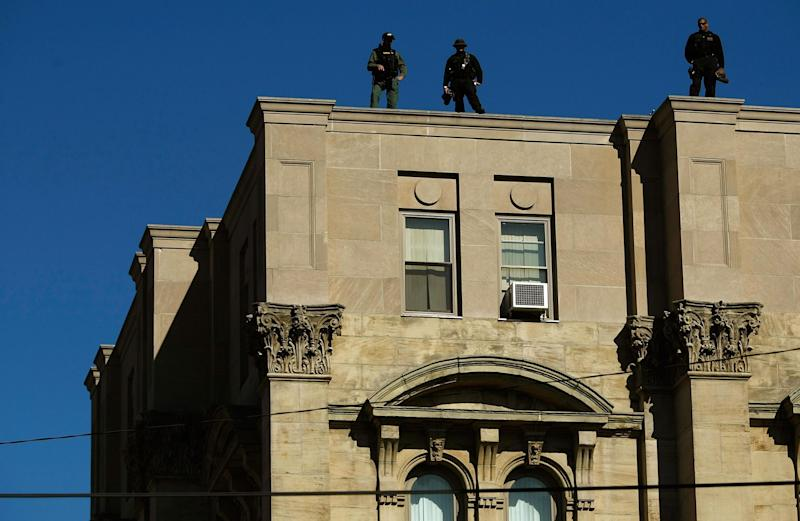 Police officers stand on top of the Jefferson County courthouse in Steubenville, Ohio in this photo from 2008: Getty/Chip Somodevilla