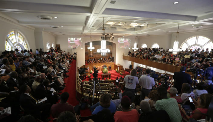 Churchgoers attend services at the 16th Street Baptist Church in Birmingham, Ala., Sunday, Sept. 15, 2013. Sunday marks the 50th anniversary of the bombing of the church by Ku Klux Klan members that killed four young girls on Sept. 15, 1963, and became a landmark moment in the civil rights struggle. (AP Photo/Dave Martin)