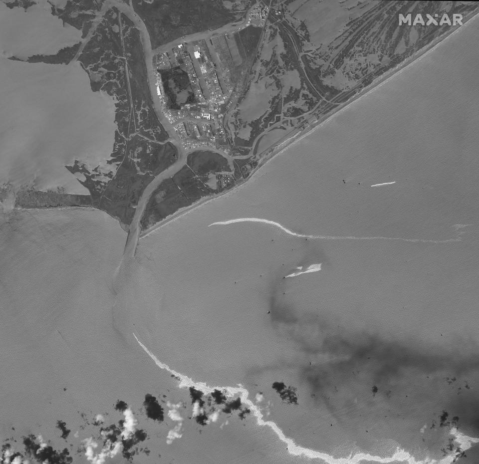This satellite image provided by Maxar Technologies shows an overview of Port Fourchon, La., and oil slicks on Sept. 2, 2021. The U.S. Coast Guard said Saturday, Sept. 4, that cleanup crews are responding to a sizable oil spill in the Gulf of Mexico following Hurricane Ida. (Maxar Technologies via AP)