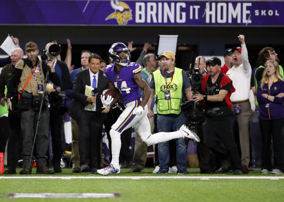 Vikings wideout Stefon Diggs dodged a tackle from the Saints' Marcus Williams and took it to the house for a 61-yard touchdown with no time left. (AP Photos)