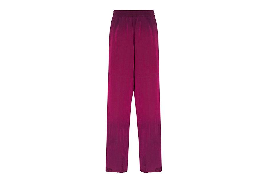 "$472, Farfetch. <a href=""https://www.farfetch.com/shopping/men/aries-ombre-dyed-track-pants-item-14834907.aspx?storeid=9359"" rel=""nofollow noopener"" target=""_blank"" data-ylk=""slk:Get it now!"" class=""link rapid-noclick-resp"">Get it now!</a>"
