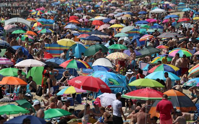 The government has threatened to close beaches after thousands of people flocked to the Dorset coast on the hottest day of the year. (PA)