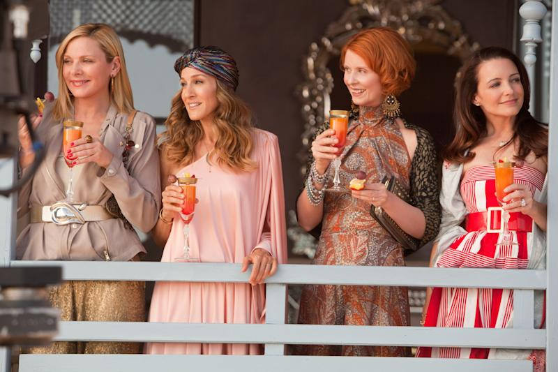 "FILE - In this undated file photo originally provided by Warner Bros., from left, actresses Kim Cattral as Samantha Jones, Sarah Jessica Parker as Carrie Bradshaw, Cynthia Nixon as Miranda Hobbes and Kristin Davis as Charlotte York are shown in a scene from ""Sex and the City 2."" (AP Photo/Warner Bros., Craig Blankenhorn)"