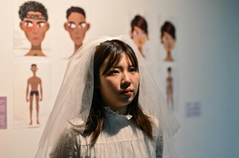 Zhang's exhibition responds to harmful stereotypes around female bodies, with participants taking part in a performance -- parodying marriage -- to celebrate and accept their bodies