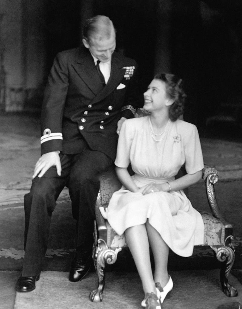 July 1947: Princess Elizabeth, the 21-year-old future queen, at Buckingham Palace with Lieutenant Philip Mountbatten, just after they announced their engagement