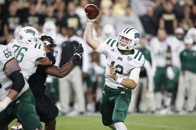 """WEST LAFAYETTE, IN – SEPTEMBER 08: <a class=""""link rapid-noclick-resp"""" href=""""/ncaaf/players/276656/"""" data-ylk=""""slk:Nathan Rourke"""">Nathan Rourke</a> #12 of the <a class=""""link rapid-noclick-resp"""" href=""""/ncaab/teams/oab/"""" data-ylk=""""slk:Ohio Bobcats"""">Ohio Bobcats</a> throws a pass in the second half of a game against the <a class=""""link rapid-noclick-resp"""" href=""""/ncaab/teams/pau/"""" data-ylk=""""slk:Purdue Boilermakers"""">Purdue Boilermakers</a> at Ross-Ade Stadium on September 8, 2017 in West Lafayette, Indiana. (Photo by Joe Robbins/Getty Images)"""