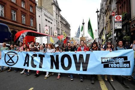 FILE PHOTO: Demonstrators march along Whitehall during an Extinction Rebellion protest in London, Britain April 23, 2019. REUTERS/Toby Melville