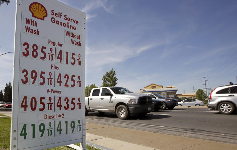 FILE - This April 23, 2019 file photo shows gas prices displayed at a Shell gasoline station in Sacramento, California Calif. The average national average in the U.S. price of regular-grade gasoline jumped 5 cents a gallon (3.8 liters) over the past two weeks, to $2.97. Industry analyst Trilby Lundberg of the Lundberg Survey says Sunday, May 5, 2019, that gas prices have spiked 66 cents since early January. (AP Photo/Rich Pedroncelli, File)
