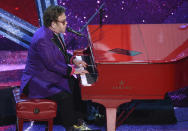 """Elton John performs """"(I'm Gonna) Love Me Again"""" nominated for the award for best original song from """"Rocketman"""" at the Oscars on Sunday, Feb. 9, 2020, at the Dolby Theatre in Los Angeles. (AP Photo/Chris Pizzello)"""