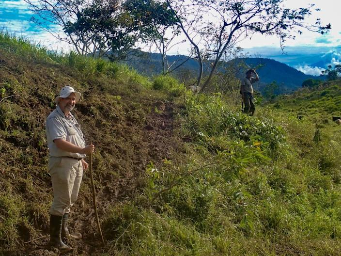 Keith Barron, the CEO and chairman of Aurania Resources, stands on a trail in southeastern Ecuador. Barron has spent more than two decades searching for two lost Spanish mines in Ecuador.