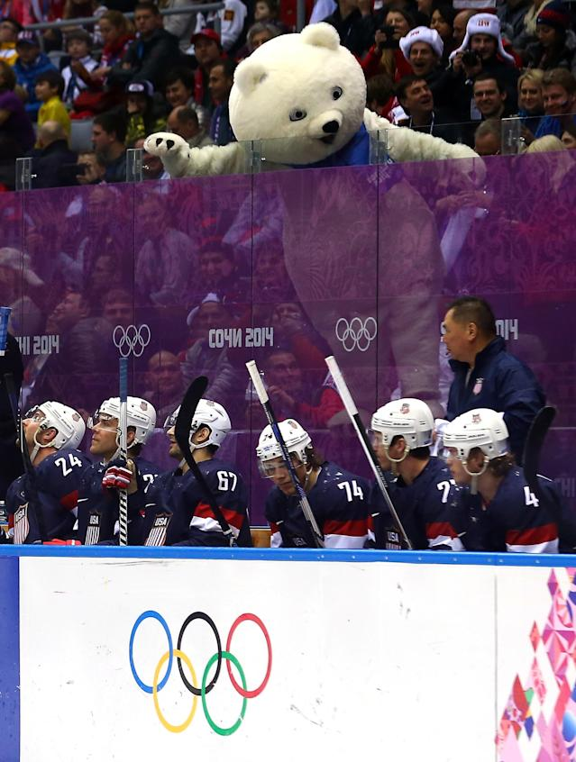 SOCHI, RUSSIA - FEBRUARY 22: The Polar Bear Olympic mascot stands over the United States bench in the first period against Finland during the Men's Ice Hockey Bronze Medal Game on Day 15 of the 2014 Sochi Winter Olympics at Bolshoy Ice Dome on February 22, 2014 in Sochi, Russia. (Photo by Streeter Lecka/Getty Images)