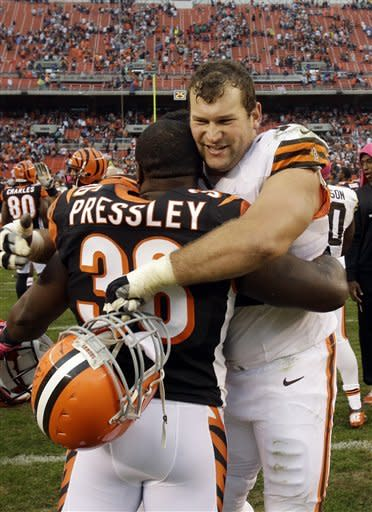 Cleveland Browns offensive tackle Joe Thomas hugs Cincinnati Bengals cornerback Shaun Prater (38) after the Browns' 34-24 win in an NFL football game Sunday, Oct. 14, 2012, in Cleveland. (AP Photo/Mark Duncan)