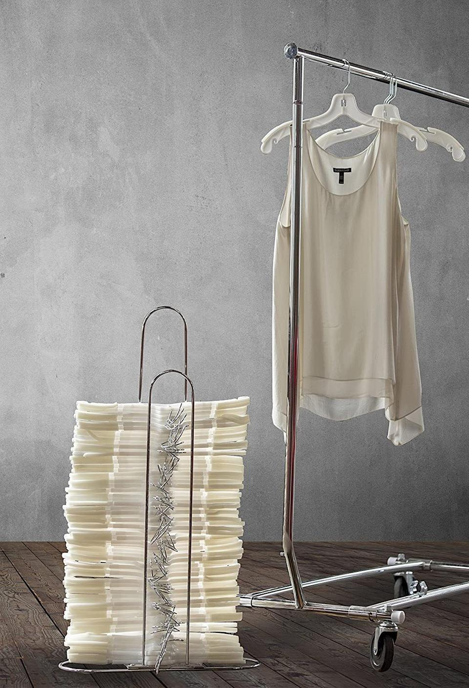 """Becauseyou're an adult and you 100% cannot have a jumbled bin of hangers.<br /><br /><strong>Promising review:</strong>""""We just moved from a two-bed to a one-bed and are trying to squeeze everything in. Anxiety is at a full-time high with all the clutter but this product helped us organize our closet while freeing up hanging space!<strong>No more random hangers here, there, and everywhere, tangled up and cluttering a room. It was SO simple to assemble. Took me maybe five minutes (tops).</strong>"""" --<a href=""""https://amzn.to/3h5ATuX"""" target=""""_blank"""" rel=""""noopener noreferrer"""">Amazon Customer</a><br /><br /><strong>Get it from Amazon for <a href=""""https://amzn.to/3haTUvU"""" target=""""_blank"""" rel=""""noopener noreferrer"""">$20.63</a>.</strong>"""