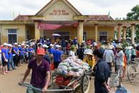 A couple transport foods relief to provide for flood affected residents at My Thuong Loc village in Quang Binh province