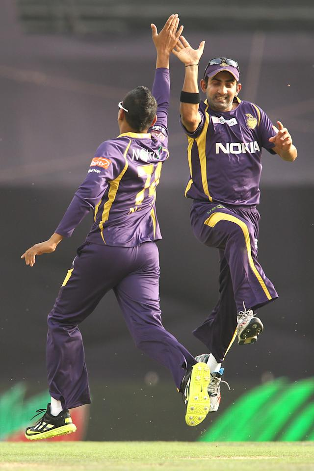Sunil Narine of Kolkata Knight Riders is congratulated  by Kolkata Knight Riders captain Gautam Gambhir for getting Azhar Mahmood of Kings XI Punjab wicket during match 20 of the Pepsi Indian Premier League between The Kings XI Punjab and the Kolkata Knight Riders held at the PCA Stadium, Mohal, India  on the 16th April 2013..Photo by Shaun Roy-IPL-SPORTZPICS  ..Use of this image is subject to the terms and conditions as outlined by the BCCI. These terms can be found by following this link:..https://ec.yimg.com/ec?url=http%3a%2f%2fwww.sportzpics.co.za%2fimage%2fI0000SoRagM2cIEc&t=1506263177&sig=pTzGQiyuU9uSyfNHYw7mAA--~D