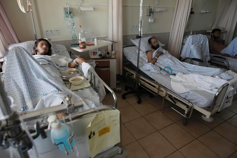 Syrian patients, who were wounded in the ongoing conflict in Syria, lie on a bed at Ziv Hospital in the northern Israeli town of Safed on March 10, 2016 (AFP Photo/JALAA MAREY)