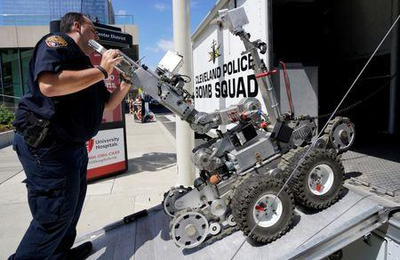 A Cleveland police bomb squad technician loads a Remotec F5A explosive ordnance device robot during a demonstration of police capabilities near the site of the Republican National Convention in Cleveland, Ohio, U.S. July 14, 2016. REUTERS/Rick Wilking