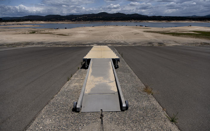 A deserted boat launch ramp sits far from receded waters at the drought-stricken Folsom Lake in Granite Bay, Calif., Saturday, May 22, 2021. California Gov. Gavin Newsom declared a drought emergency for most of the state. (AP Photo/Josh Edelson)