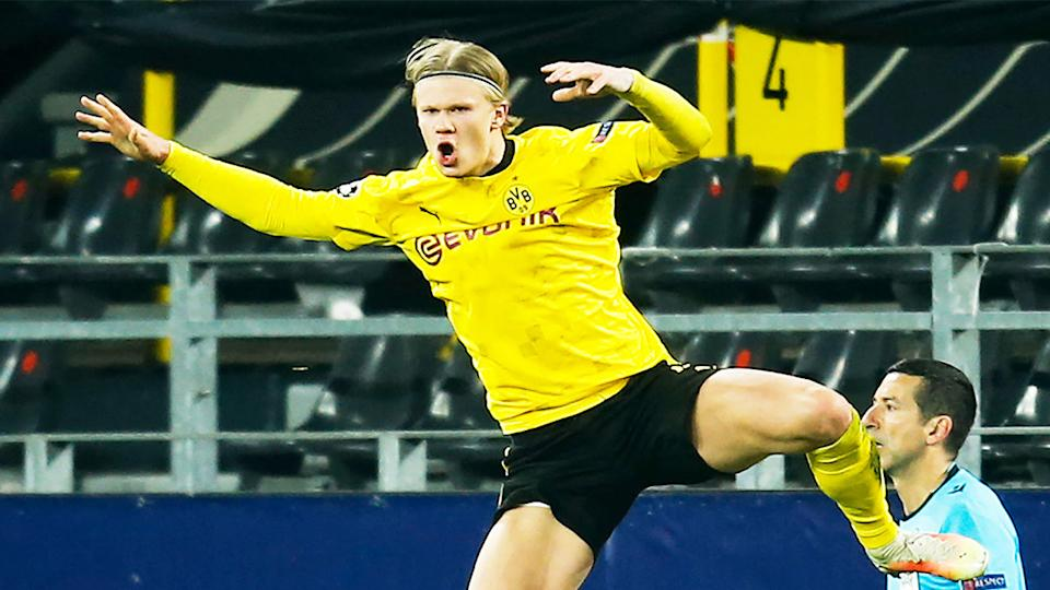 Dortmund star Erling Haaland (pictured) jumping in the air to celebrate his goal against Sevilla.
