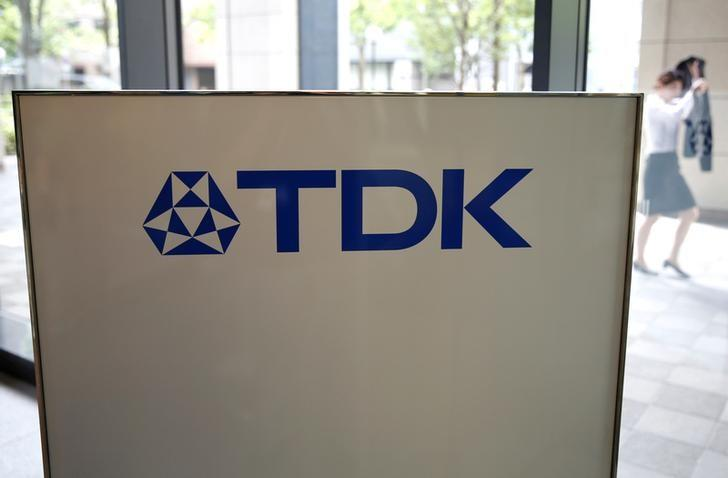 The logo of TDK Corp. is displayed at the entrance of the company headquarters building in Tokyo