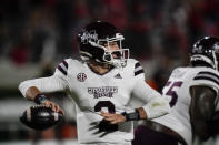 Mississippi State quarterback Will Rogers looks for a receiver during the first half of the team's NCAA college football game against Georgia on Saturday, Nov. 21, 2020, in Athens, Ga. (AP Photo/Brynn Anderson)